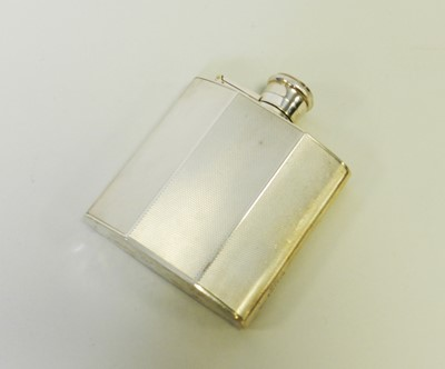 Lot 7 - An engine turned silver hip flask