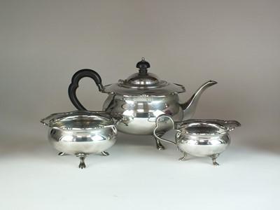 Lot 11 - A three piece silver tea service