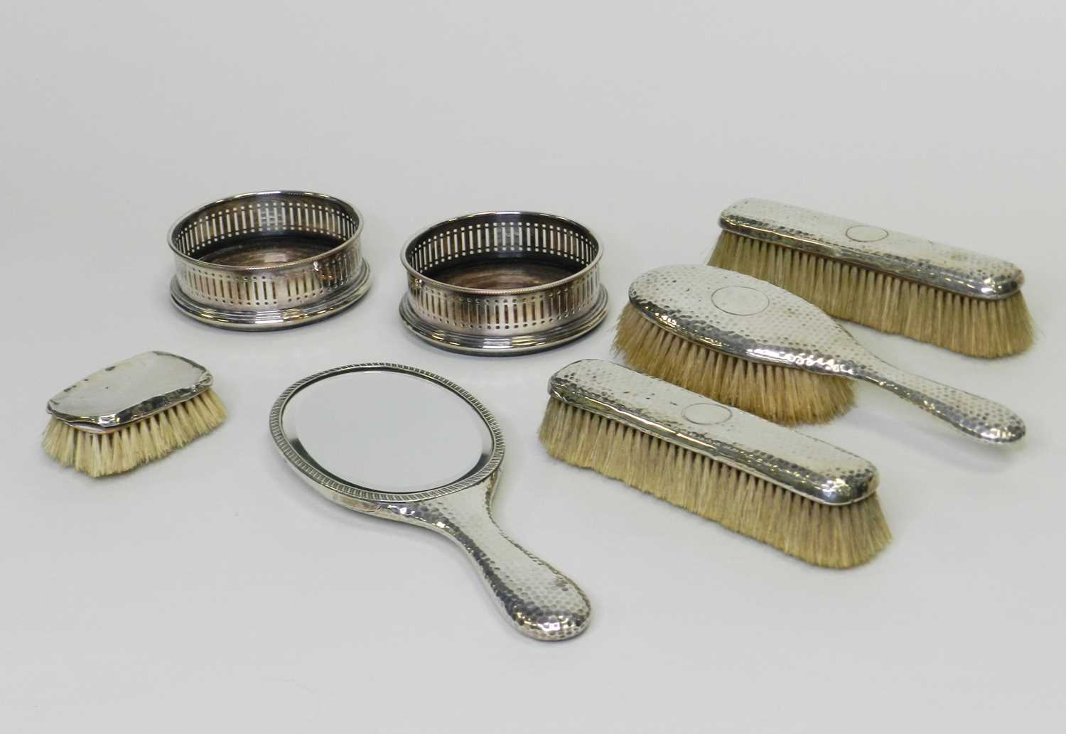 Lot 18 - A matched collection of four silver mounted dressing tablewares
