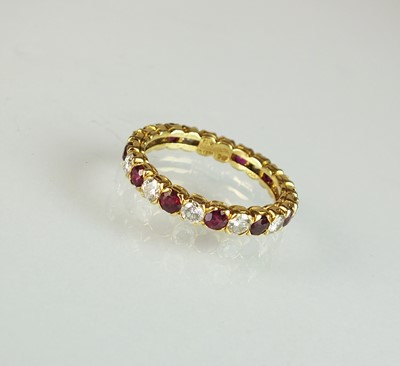 Lot 37 - An 18ct gold ruby and diamond full eternity ring by Boucheron