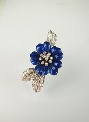 Lot 34 - A blue enamel and diamond flower brooch by Boucheron