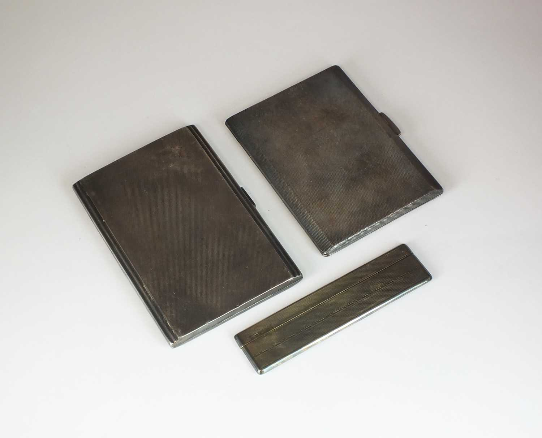 Lot 10 - Two silver cigarette cases and a silver comb