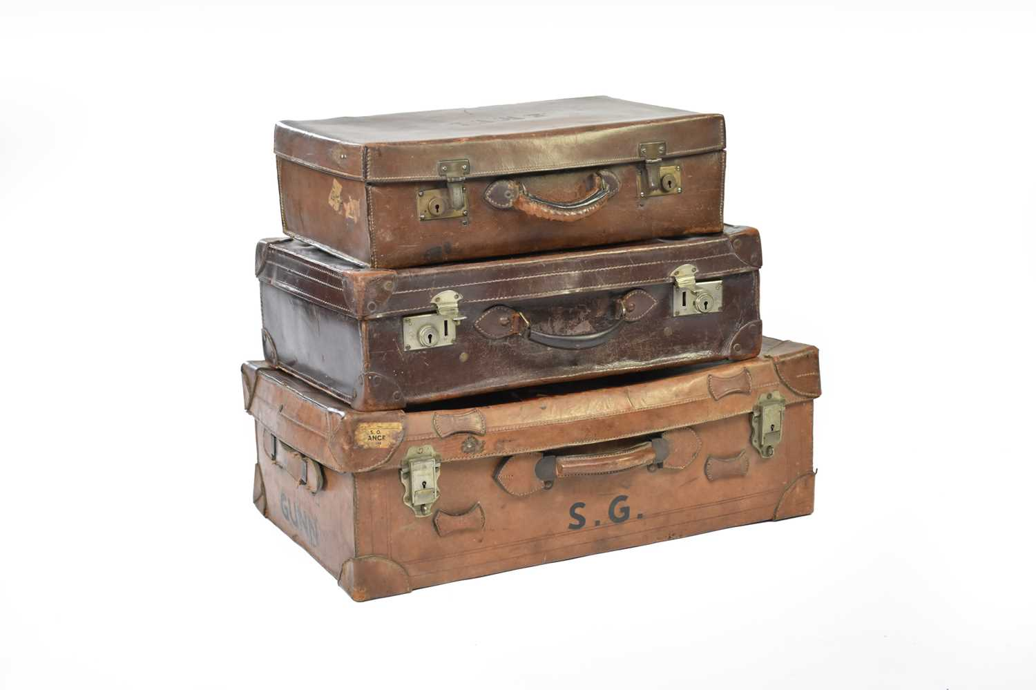 Lot 22 - Three vintage graduated leather suitcases