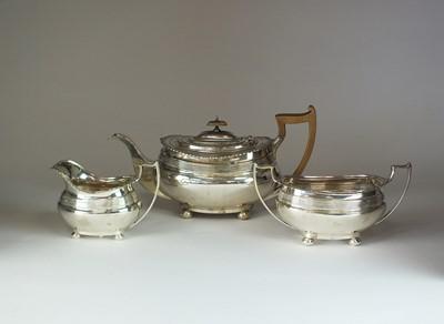 Lot 21 - A three piece silver tea service