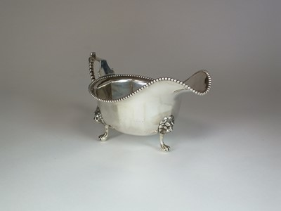 Lot 8 - A silver sauce boat