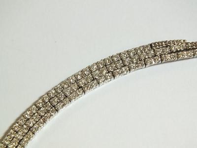 Lot 55 - A diamond set stylised tassel fringe necklace