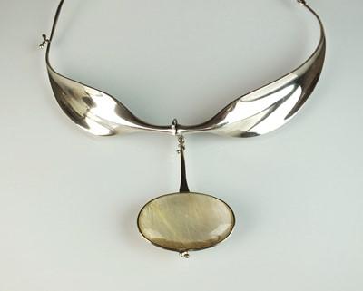 Lot 42 - A Georg Jensen silver neck ring and rutilated quartz pendant designed by Vivianna Torun Bulow-Hube