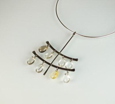 Lot 43 - A Georg Jensen silver neck ring and rutilated quartz pendant