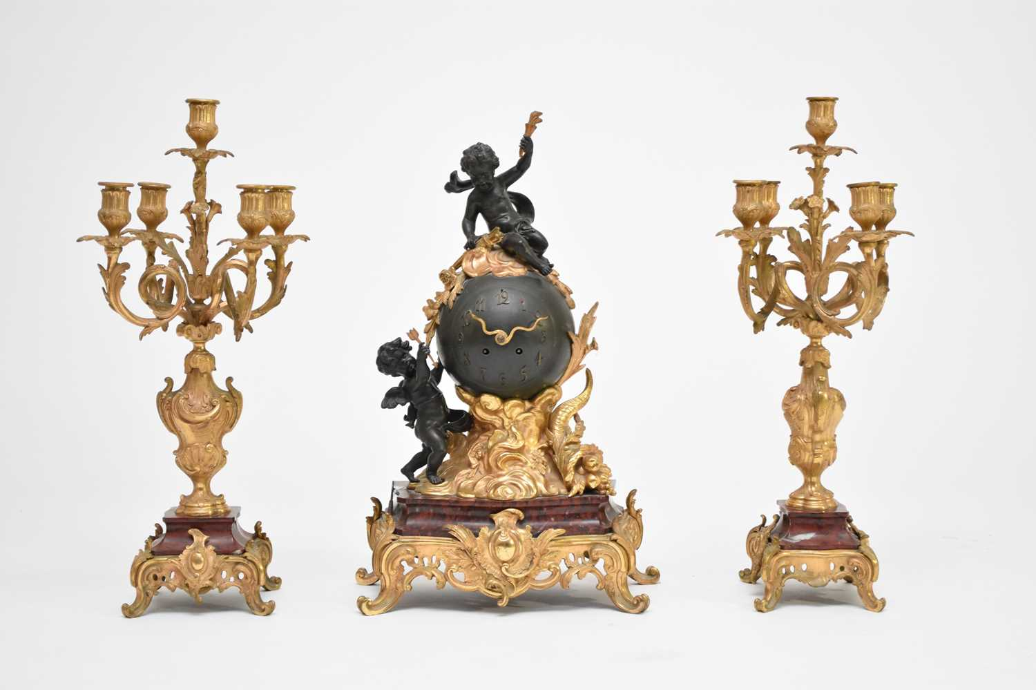 437 - A late 19th/early 20th century, French, Rococo style, ormolu and marble mantel clock garniture