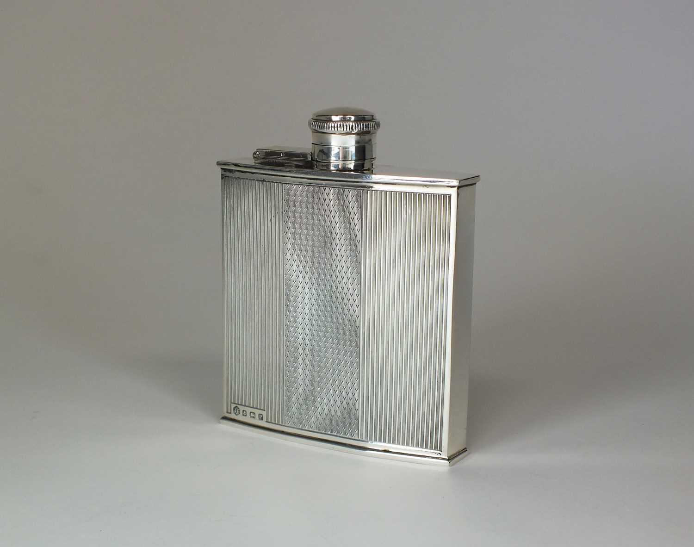 Lot 3 - An Art Deco silver hip flask