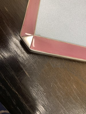 Lot 15 - An Art Deco pink enamel and silver mounted frame