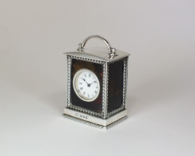 Lot 9 - A silver and tortoiseshell mounted carriage timepiece