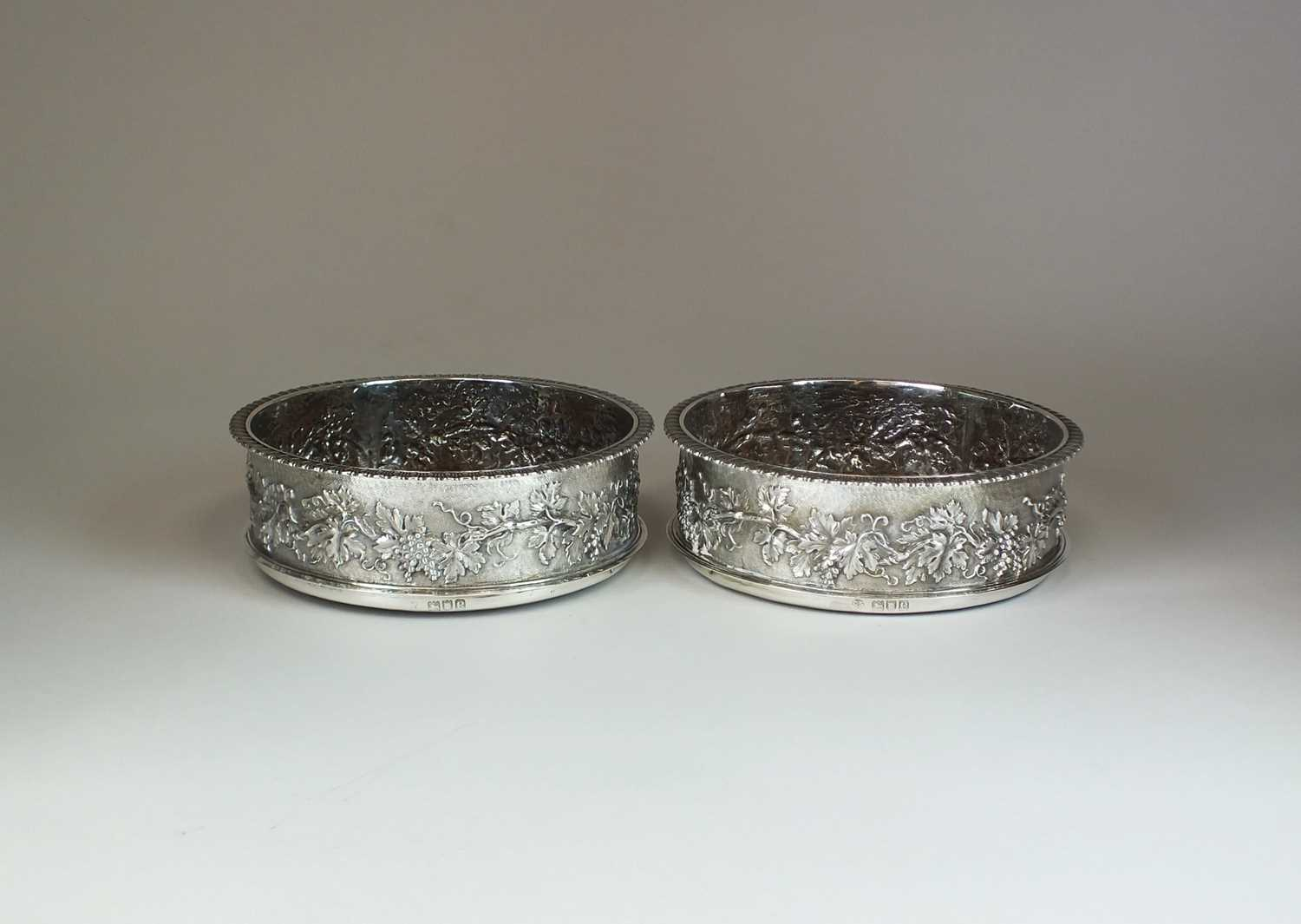 Lot 22 - A pair of late Victorian silver mounted Magnum wine coasters
