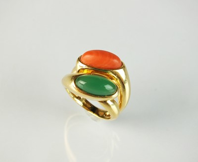 Lot 32 - An 18ct gold coral and chrysoprase crossover dress ring by Boucheron