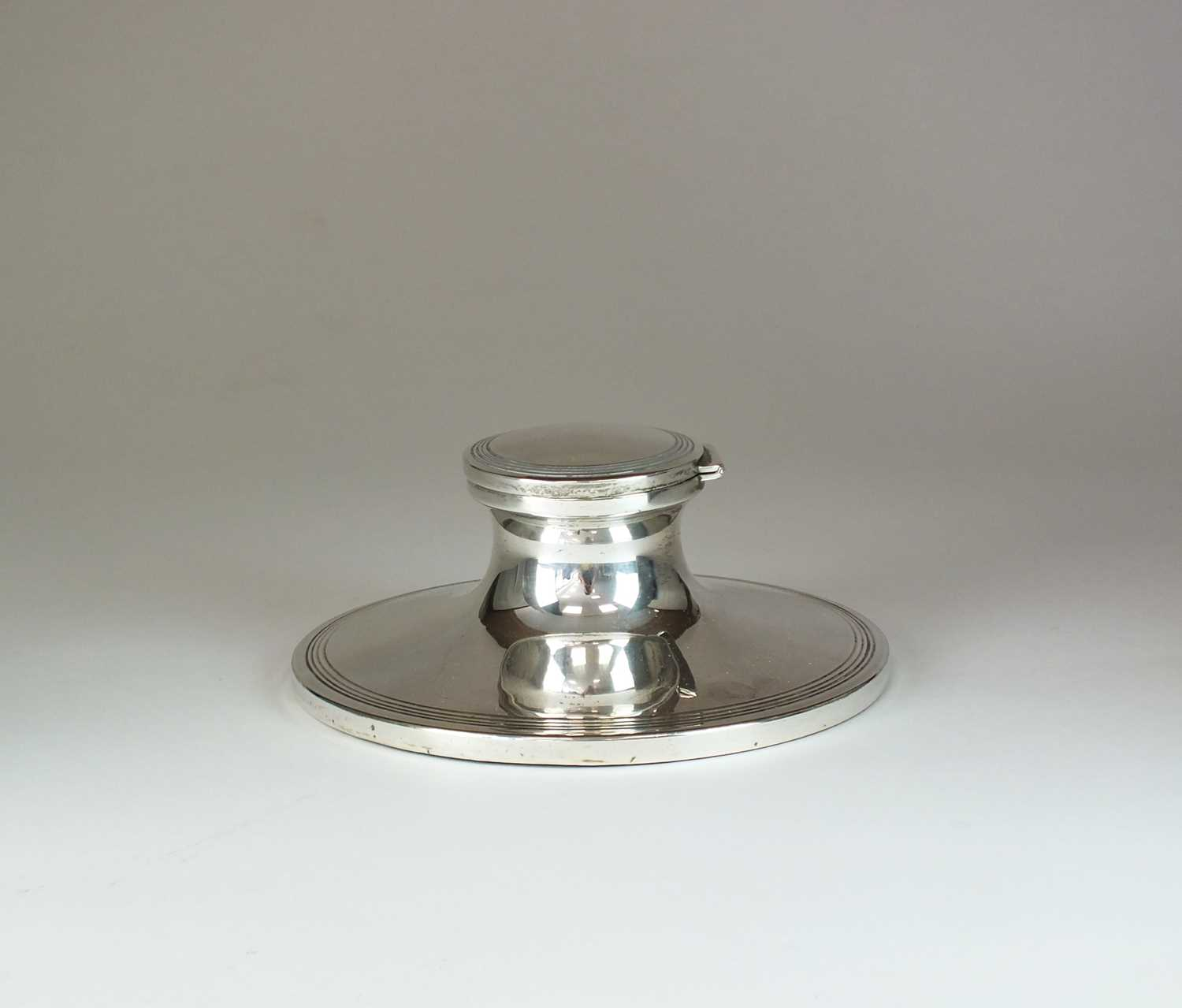 Lot 2 - A large silver mounted capstan ink well