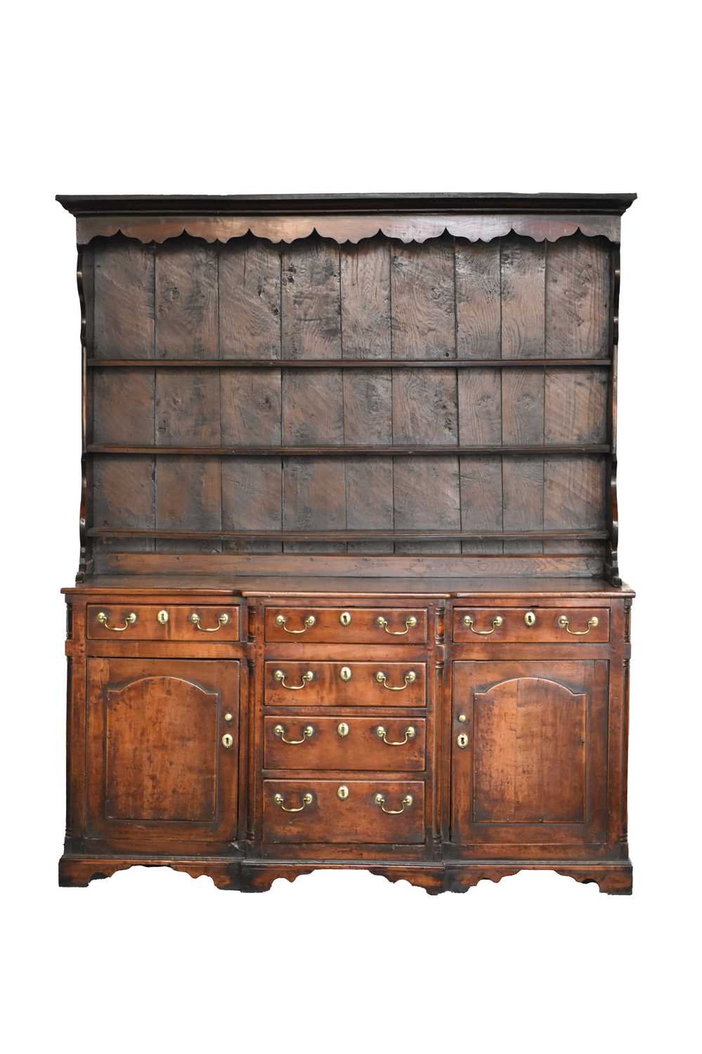 460 - A late 18th century fruitwood or yew wood breakfront dresser, North Wales