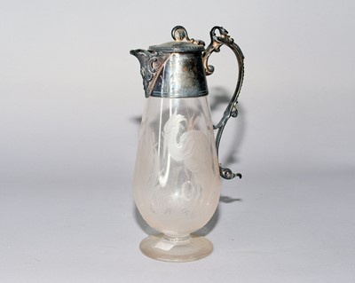 Lot 26 - An electroplated mounted glass jug