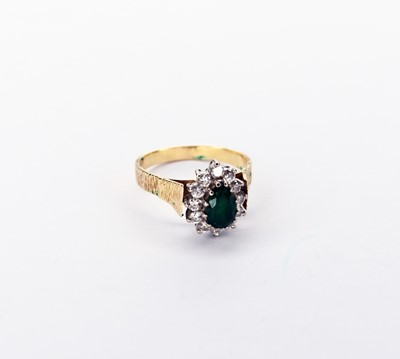 Lot 43 - An emerald and diamond cluster ring