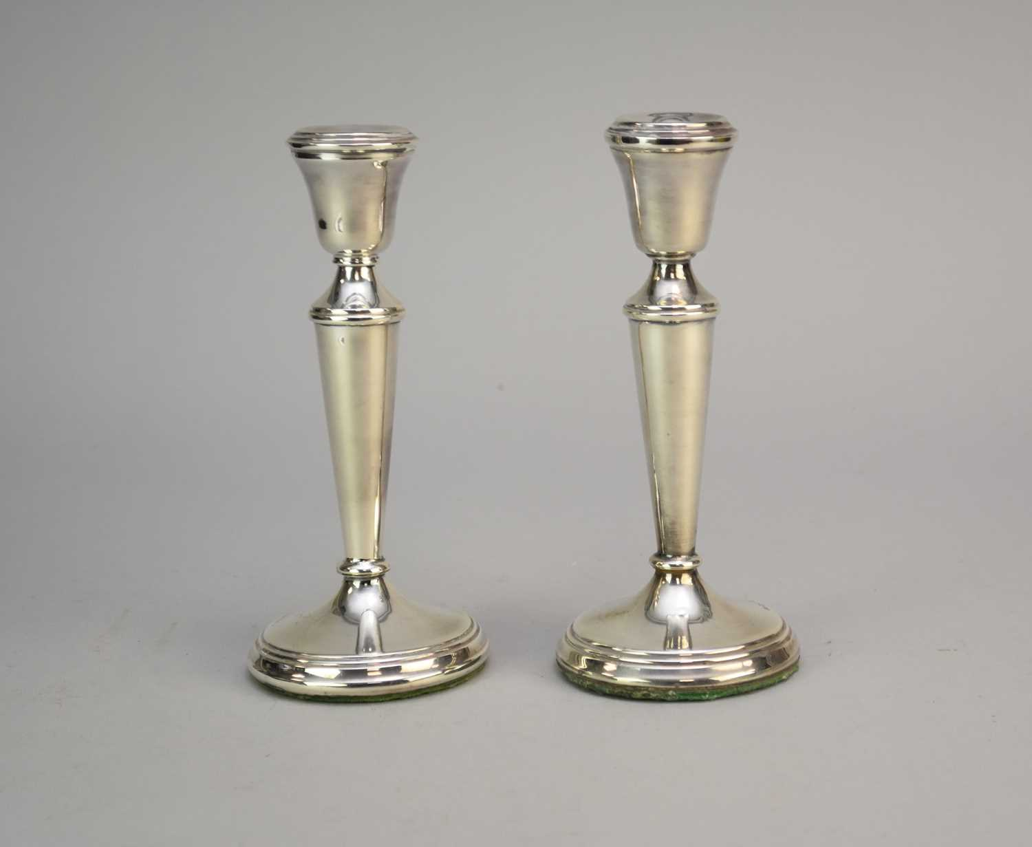 Lot 8 - A pair of Dutch silver mounted candlesticks