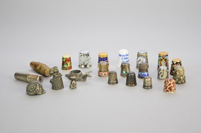 Lot 21 - A collection of white metal, enamel, gilt and ceramic thimbles