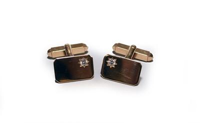 Lot 40 - A pair of yellow metal diamond set cufflinks