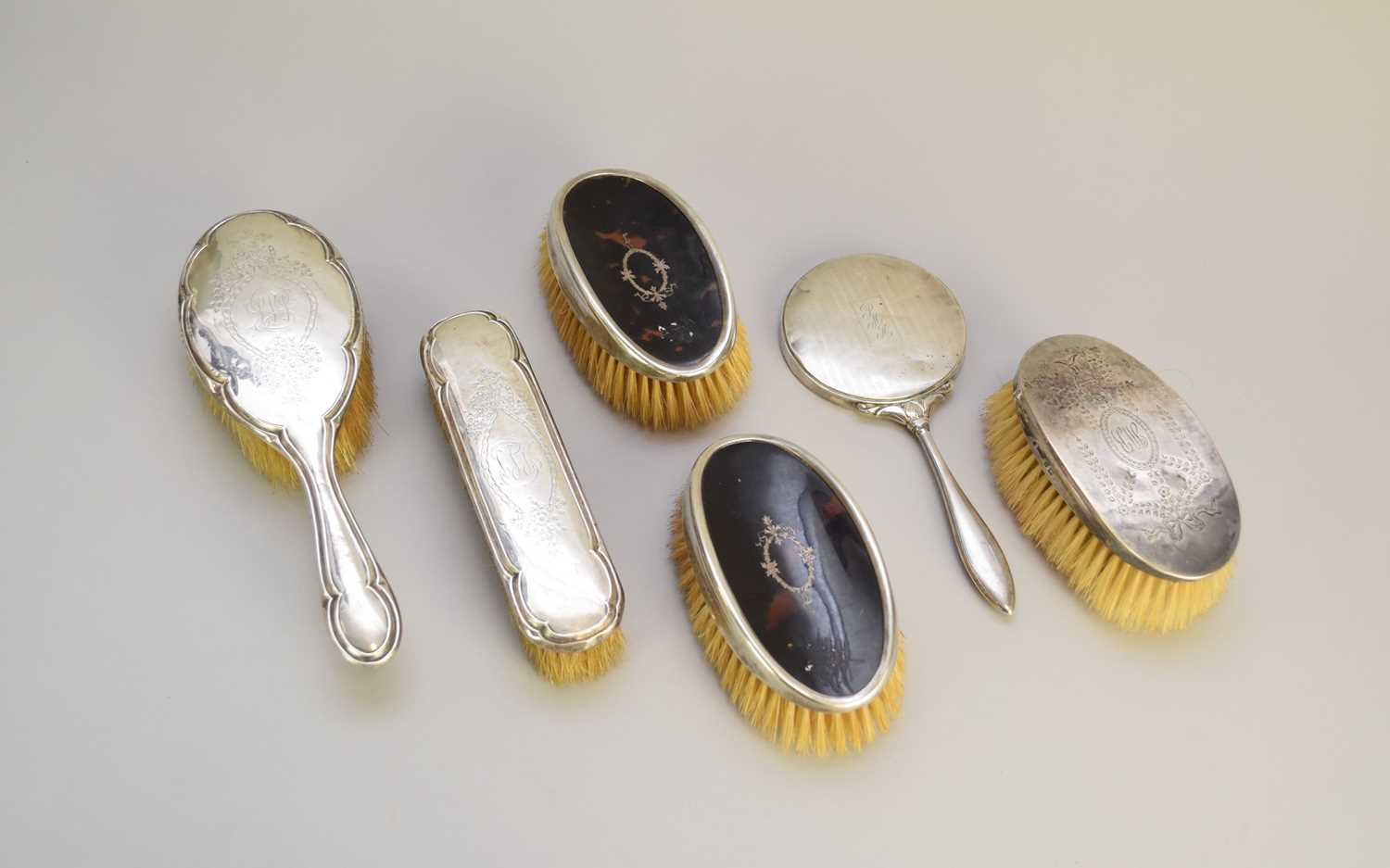Lot 10 - A collection of silver mounted dressing table wares
