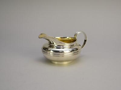 Lot 12 - A George IV silver cream jug