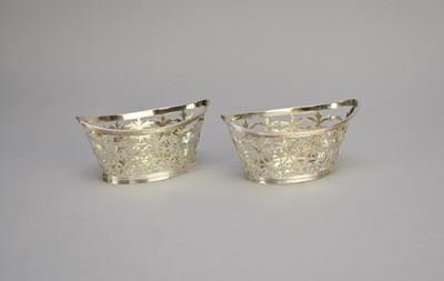 Lot 22 - A pair of late Victorian pierced silver bon bon dishes