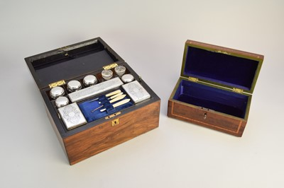 Lot 18 - A 19th century cased silver plated mounted travelling vanity set