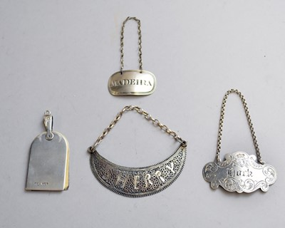 Lot 5 - A silver aide memoire and decanter labels