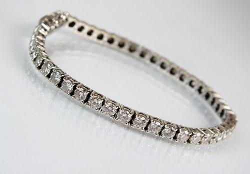 Lot 259-A diamond set tennis bracelet, comprising...