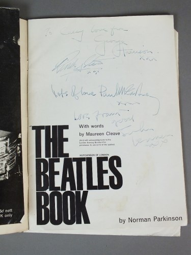 Lot 334 - A set of Beatles signatures contained in a...