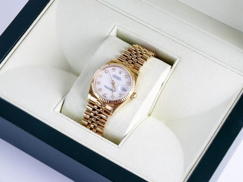 Lot 217-A Lady's Rolex 18ct yellow gold Oyster Perpetual...