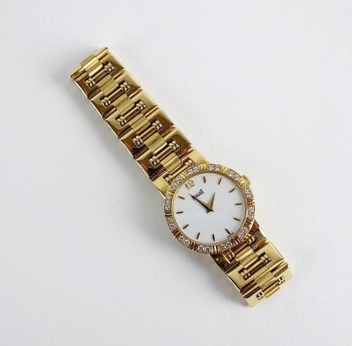 Lot 225-A Lady's 18ct gold and diamond set Piaget Lady...