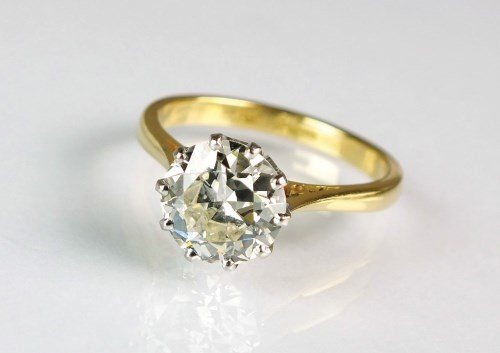 Lot 277-An 18ct gold single stone diamond ring, the...