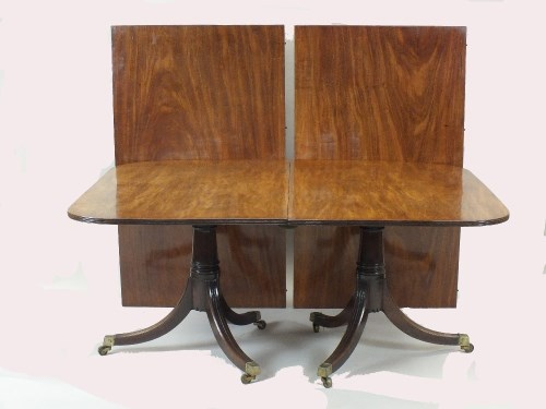Lot 777-A mahogany twin pillar dining table, George III...